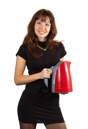 electric tea kettle: Woman with electric tea kettle. Isolated ove white background