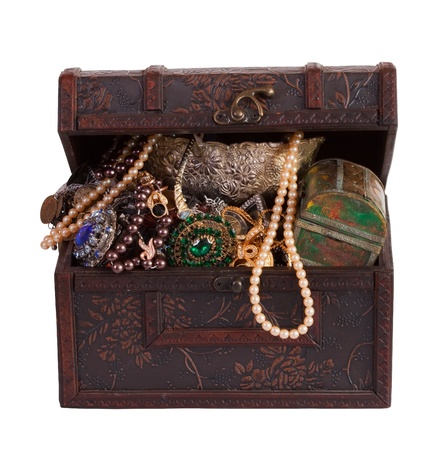 Wooden treasure trunk with jewellery  photo
