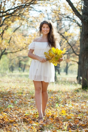 happy seasonable: Full length shot of girl  in autumn park