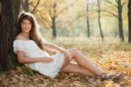happy seasonable: Outdoor portrait of girl in white dress at autumn park  Stock Photo