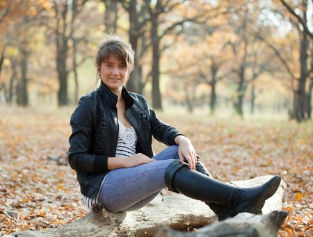 boots: Girl in jacket and black high shoes at autumn park