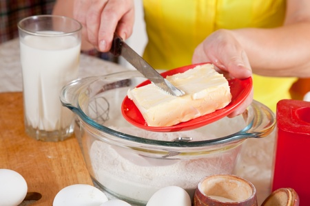 Closeup of cook hands adds margarine into dough Stock Photo - 11955102