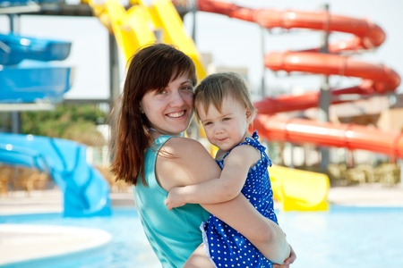 amusement: happy mother with  toddler at aquapark