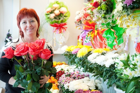 small flower: Female florist in her small  flower shop Stock Photo