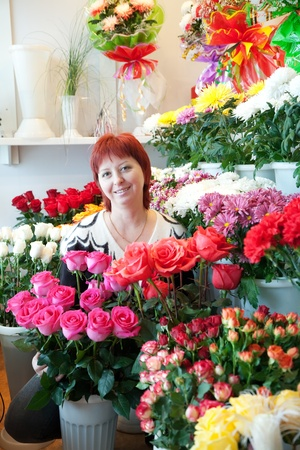 Middle-aged woman in her small  flower shop Stock Photo - 11991689
