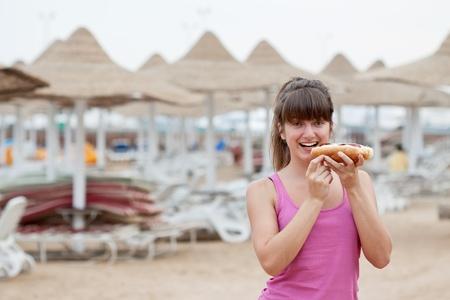 girl eating hot dog at the resort photo
