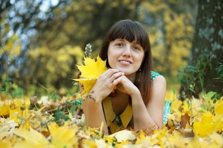 happy seasonable: Outdoor portrait of young brunette woman in autumn park  Stock Photo