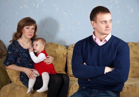 young family after quarrel in home photo