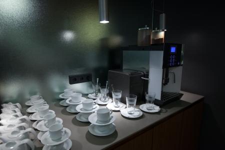 percolate:  coffee machine and mugs in bar