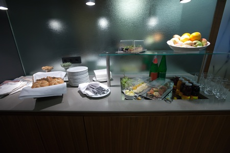 Buffet with cutlery and  dessert photo