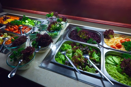 vegetables in trays  at buffet  photo