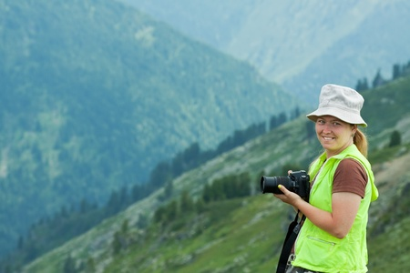 photocamera: photographer tourist with photocamera at mountains