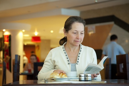 Woman having breakfast in hotel restaurant Stock Photo - 12077204