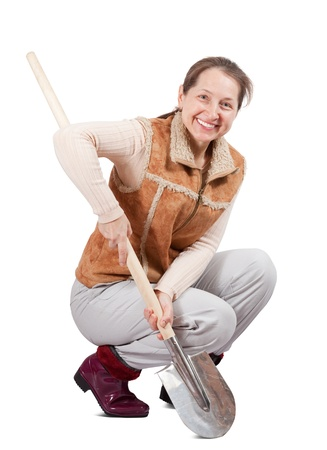 welly: Happy pastoral   woman  spading with spade over white Stock Photo