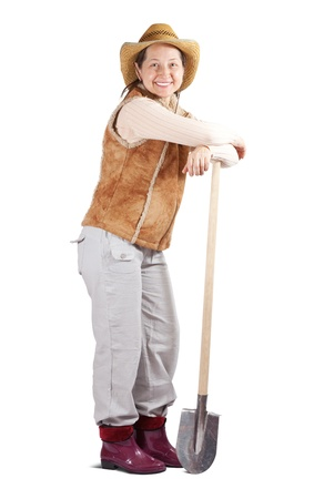 full length shot of happy mature woman with spade over white photo