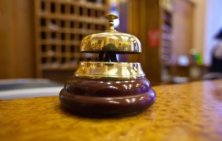 Golden bell on  reception desk in hotel Stock Photo - 12077316