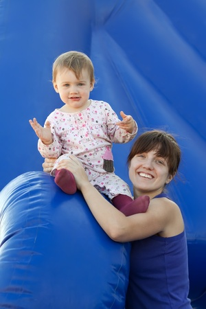 happy mother with  toddler at playground area Stock Photo - 12077314