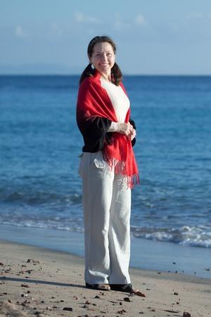 Happy mature woman on sand beach Stock Photo - 12231938