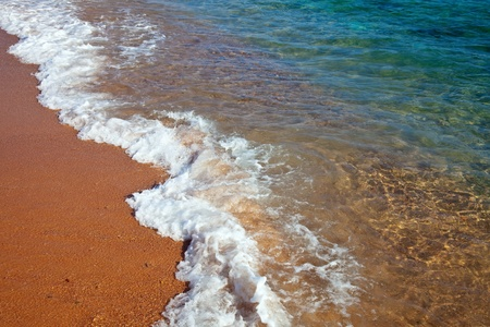 sea wave at sand beach in sunny day Stock Photo - 12238333