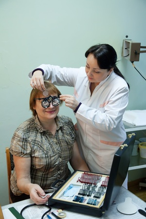 ophthalmologist  and patient testing  eyesight  in clinic Stock Photo - 12238340