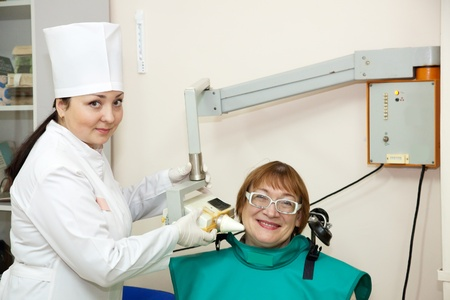 Dentist makes teeth X-ray  in clinic Stock Photo - 12238336