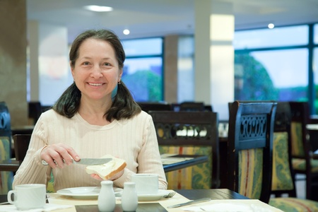 Woman having breakfast in hotel restaurant Stock Photo - 12262321