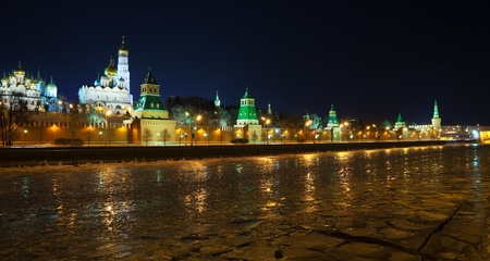 Kind to the Moscow Kremlin  and   Moskva River in winter night. Russia