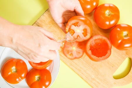 farcie: Closeup of cooking farci tomato. See in series stages of cooking of farci tomato