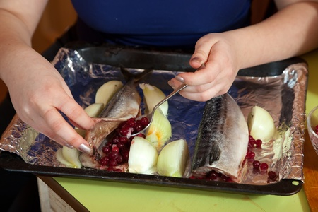 farcie: Closeup of  cook making  mackerel with cranberries