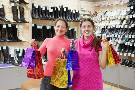 Two happy women with shopping bags at  shoes shop Stock Photo - 12271383