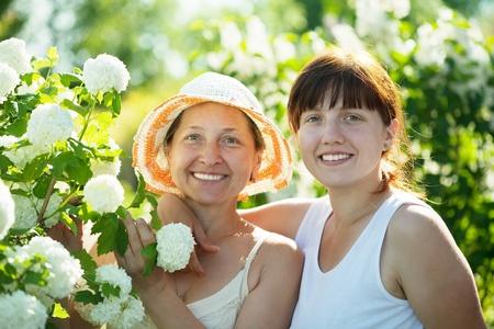 Two women in Roseum plant at garden photo
