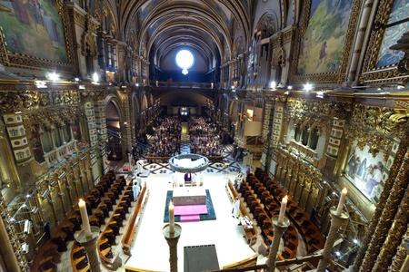 worshipers: SANTA MARIA DE MONTSERRAT, SPAIN - 9 APRIL: Worshipers during worship in catholic church on April 9, Montserrat mountain, Spain. Santa Maria de Montserrat in  greatest monastery of Catalonia