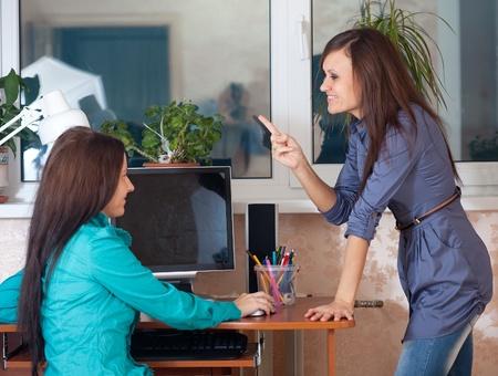 specifying: Two women works in office