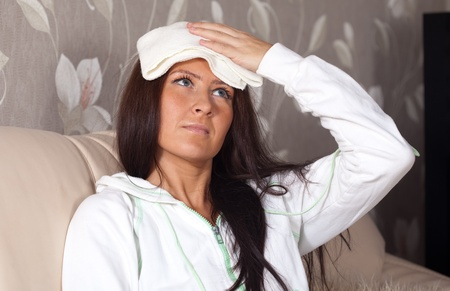 Suffering girl stupes  towel to her head Stock Photo - 12289295