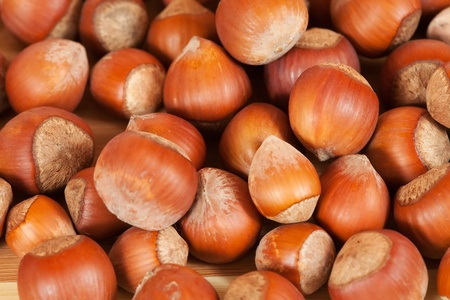 Background of ripe brown hazelnuts. Shallow DOF Stock Photo - 12289141