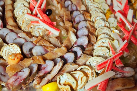 cold cuts fish  on banquet table in buffet   photo