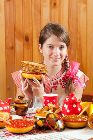sudarium: Girl in traditional  clothes with pancake during  Shrovetide
