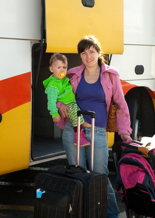 motorbus: Mother and child traveling on commercial bus