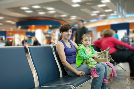 Happy mother and her child at airport Stock Photo - 12271344