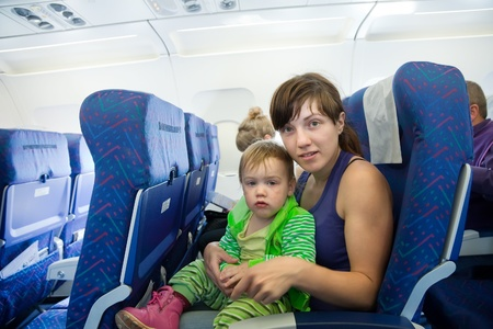 women with child in the airplane cabin