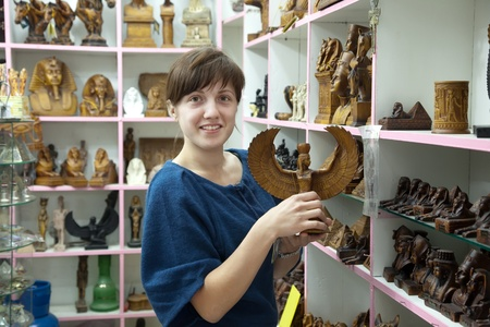 woman  chooses souvenirs in egyptian shop Stock Photo - 12271330