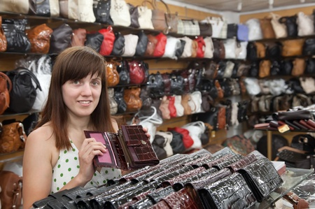 woman chooses leather wallet at   shop Stock Photo - 12271326
