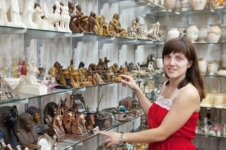 Female tourist  chooses souvenir  in egyptian shop