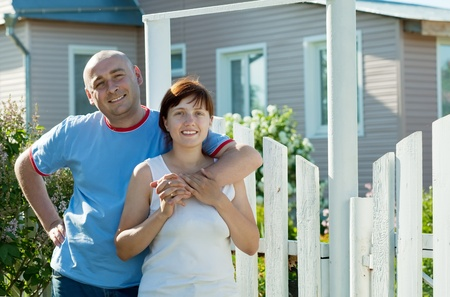 happy couple posing in front of his  residence Stock Photo - 12289013