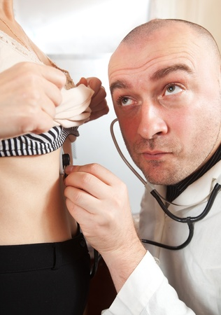 Doctor listening  the patient with  stethoscope in clinic photo