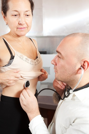 auscultoscope: Male doctor examining the patient in clinic