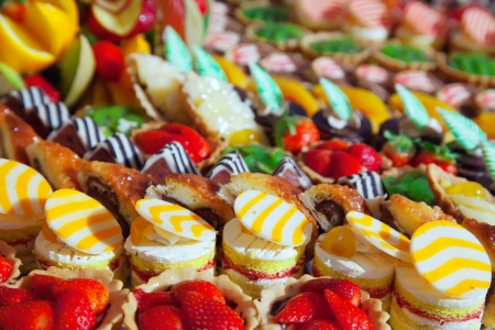 cake decorating: Different fresh cakes on banquet table