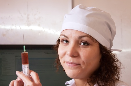 Portrait of nurse  with syringe in clinic  photo