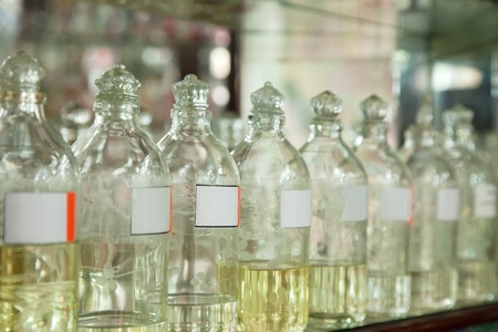 attar:  Bottles with essential oils at shop counter Stock Photo