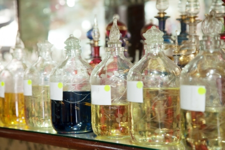 reconstituted:  Bottles with essential oils at shop counter Stock Photo